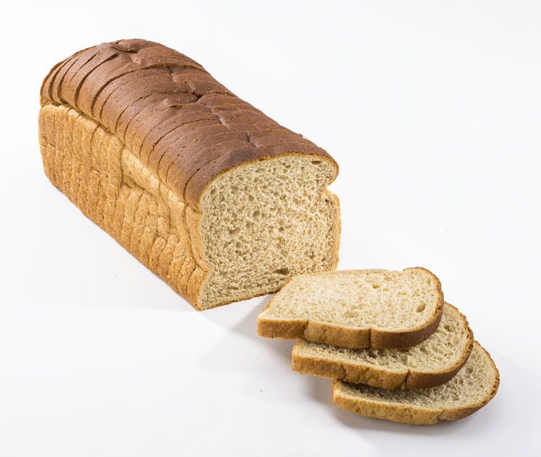sliced loaf of Gold Medal Bakery 100% whole wheat bread