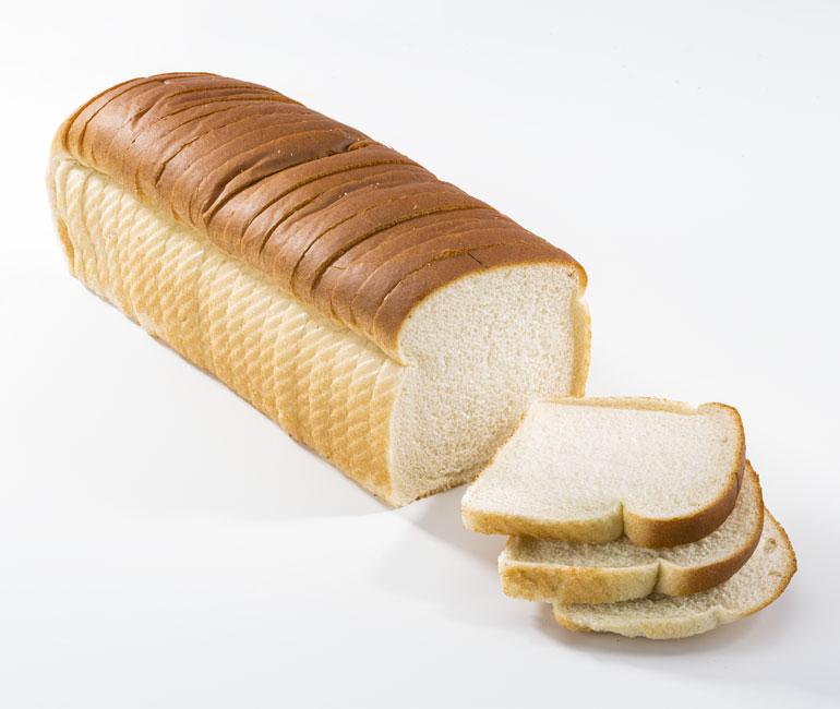 sliced giant loaf of Gold Medal Bakery white bread