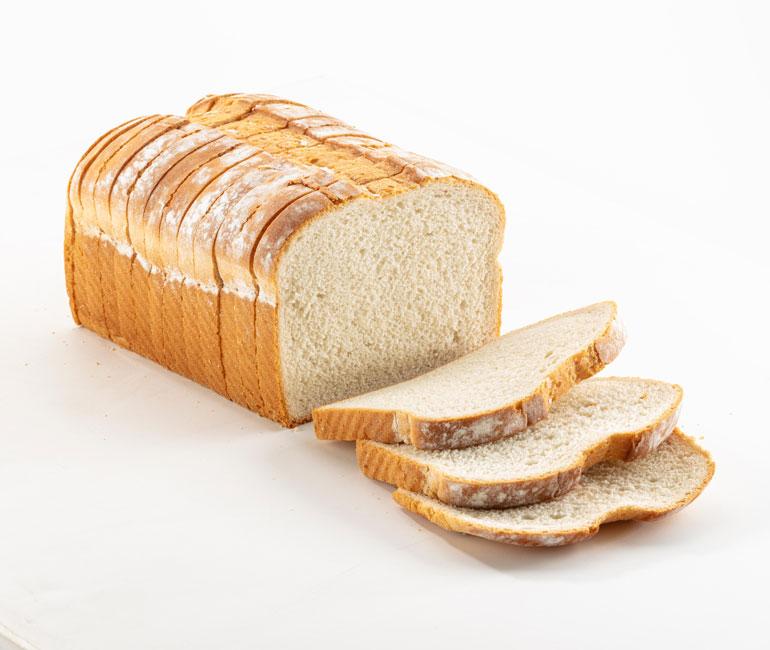 sliced loaf of Gold Medal Bakery premium white bread