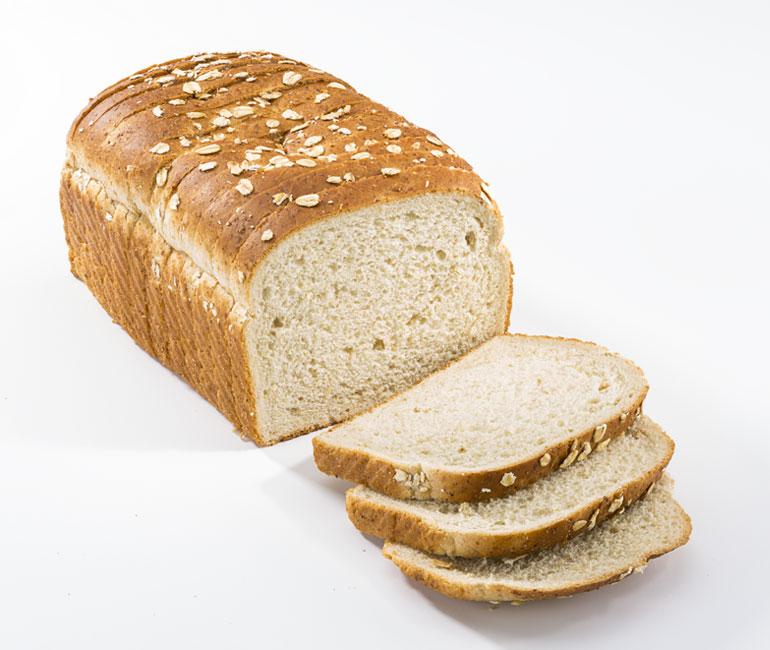 sliced loaf of Gold Medal Bakery premium oatmeal bread