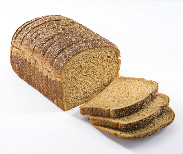 sliced loaf of Gold Medal Bakery stoneground wheat bread