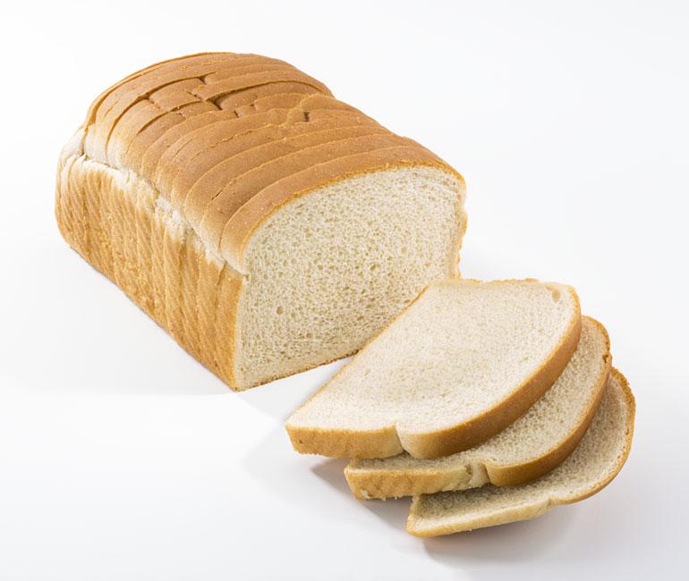 sliced loaf of Gold Medal Bakery natural white bread