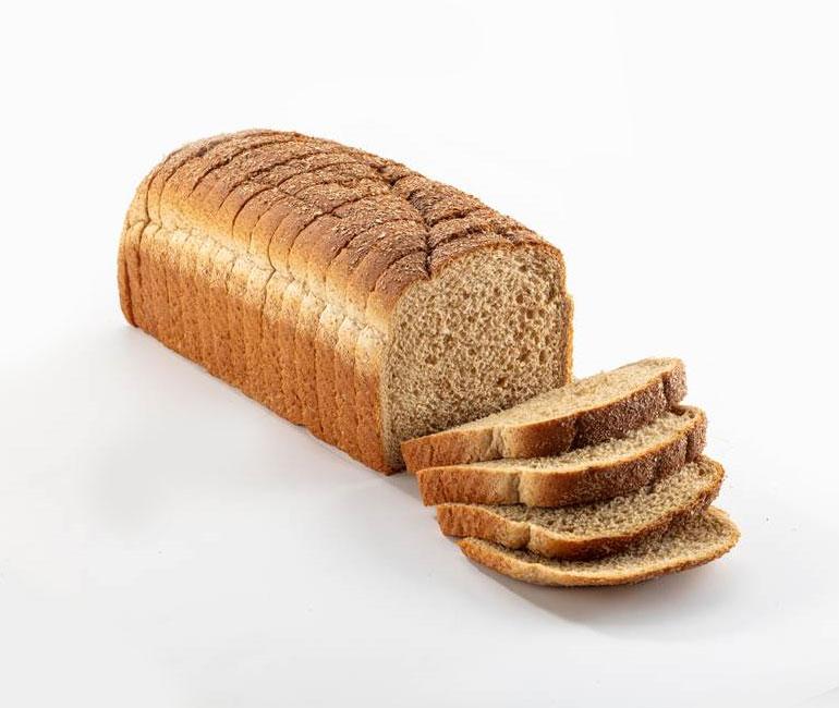 sliced loaf of Gold Medal Bakery honey wheat bread