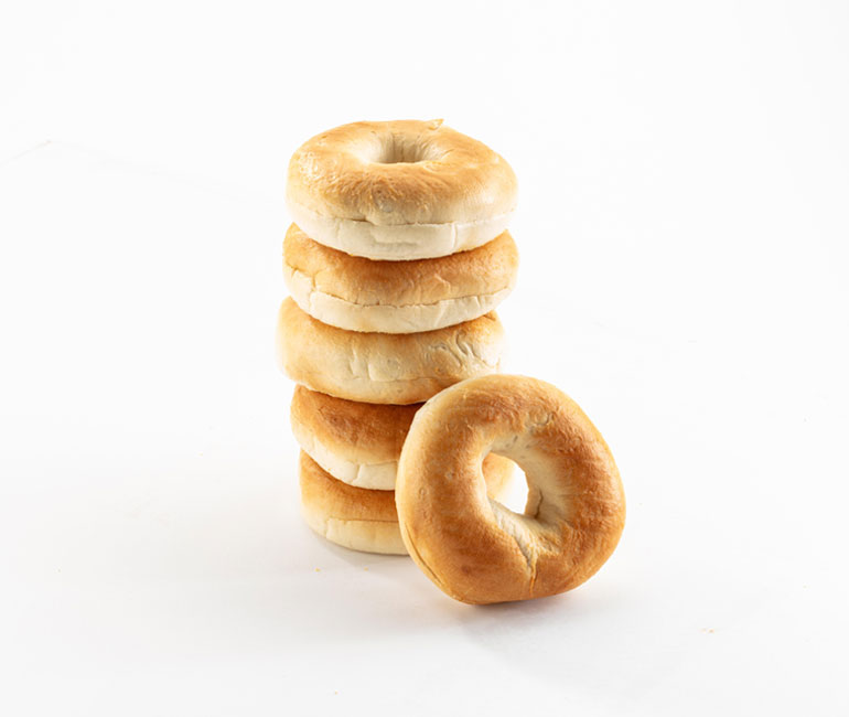 stack of plain bagels from Gold Medal Bakery