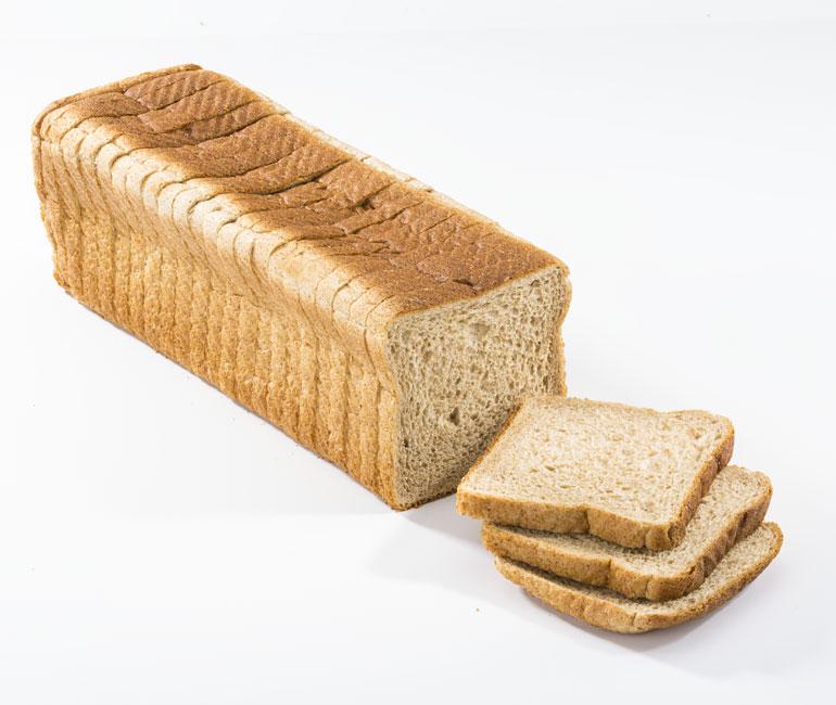 sliced loaf of Gold Medal Bakery wheat sandwich bread