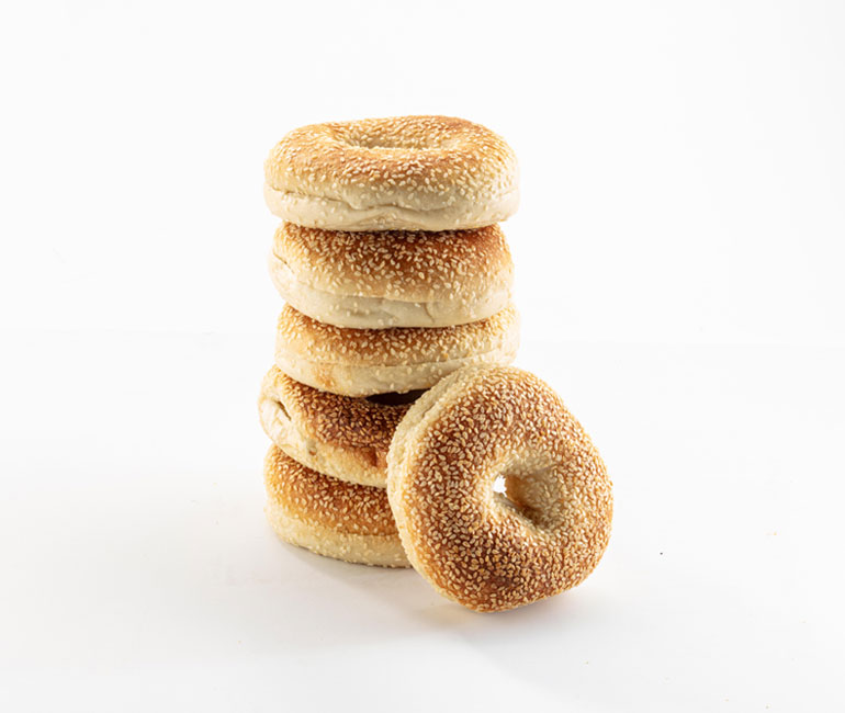 stack of sesame bagels from Gold Medal Bakery