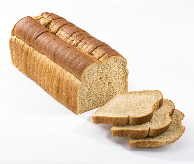 sliced loaf of Gold Medal Bakery split top wheat bread